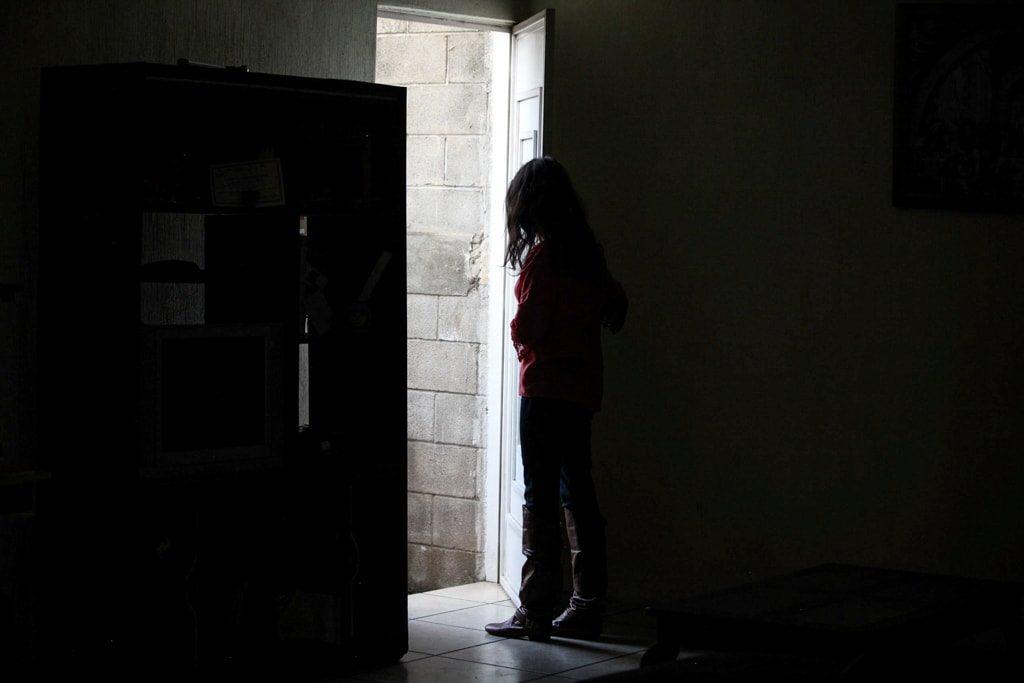 María, en su casa.